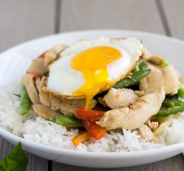 Pad Kra Pao Gai- Thai Spicy Basil with Chicken topped with a fried egg and runny yolk