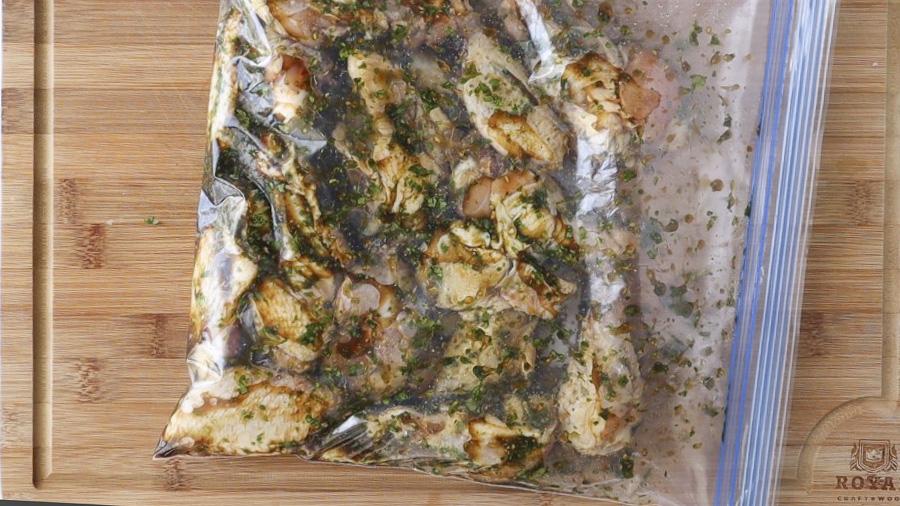 Chicken in a zip top bag with marinade.