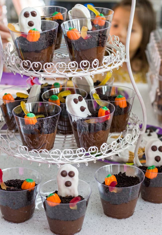 Chocolate Pudding Cups with crushed oreos on top and gummy worms.