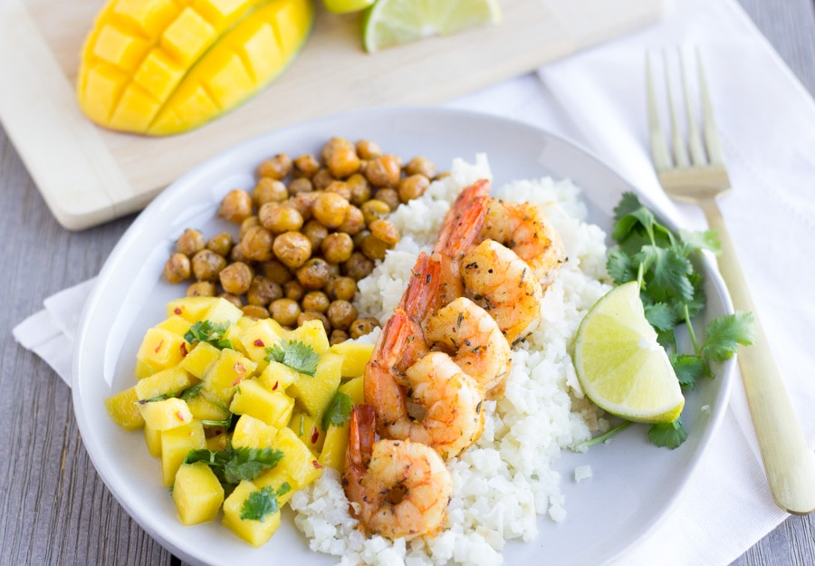 Horizontal view of shrimp on a white plate.