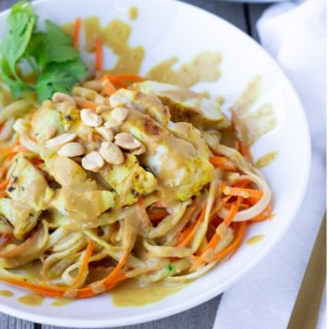 Spiralized Zucchinni and Carrots topped with Chicken Satay and a peanut sauce.
