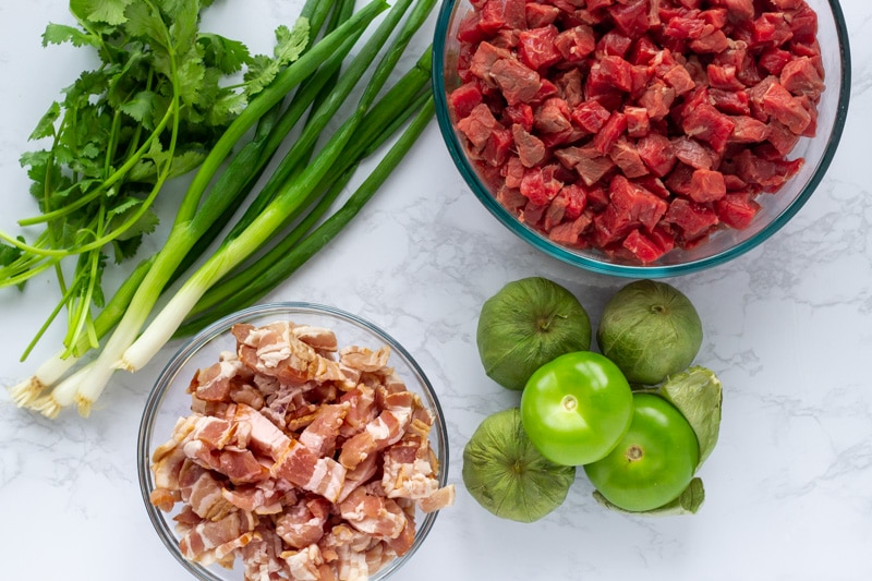 Ingredients - Beef, bacon, tomatillos, green onion, cilantro.