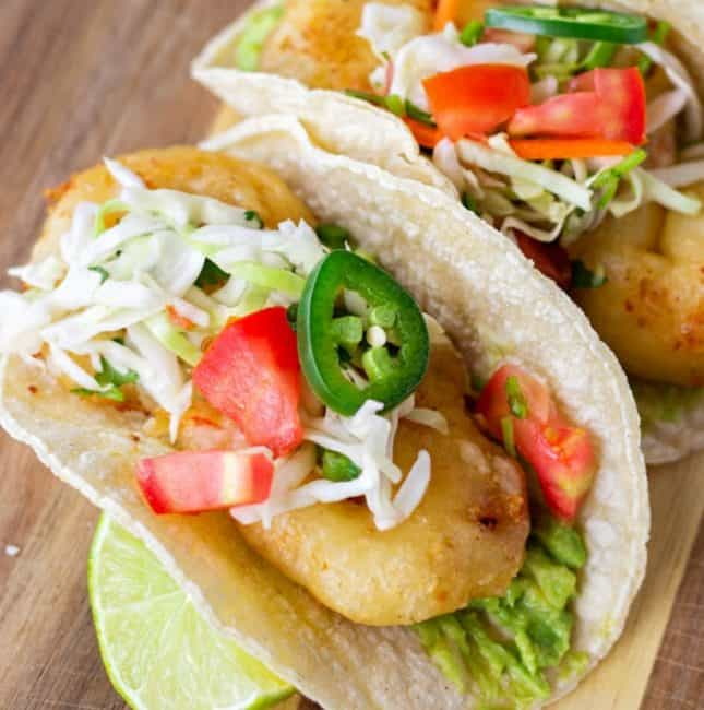 Fried Shrimp tacos on corn tortillas topped with cabbage slaw.