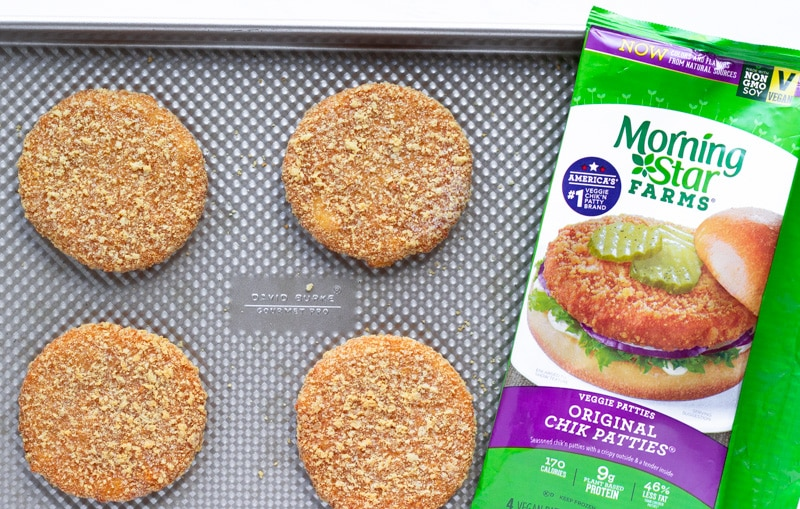 Chik Patties on a baking sheet with package of product next to it.