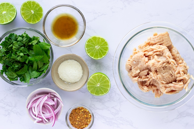 Overhead view of ingredients in individual bowls.
