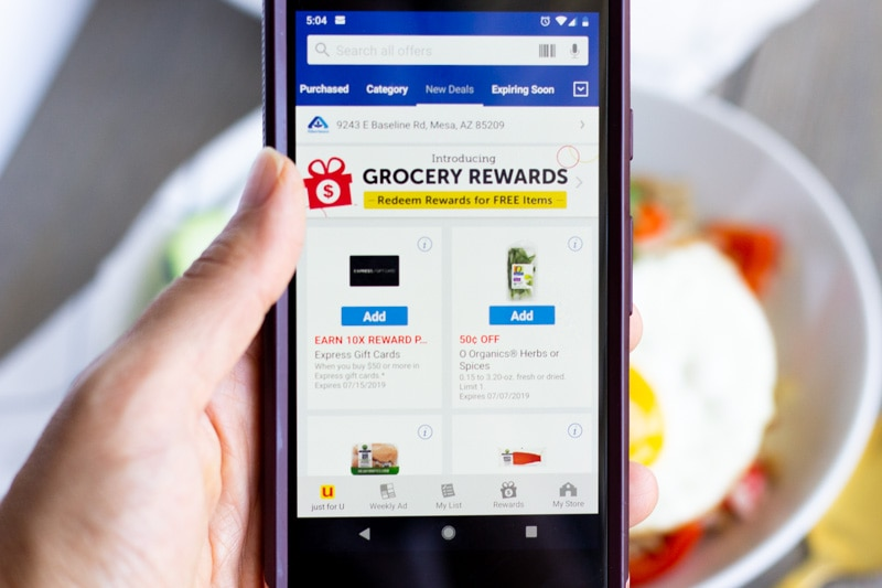 Image of mobile phone on the Albertsons coupon page
