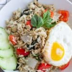 Overhead view of finished Thai Basil Fried rice and topped with a fried egg.
