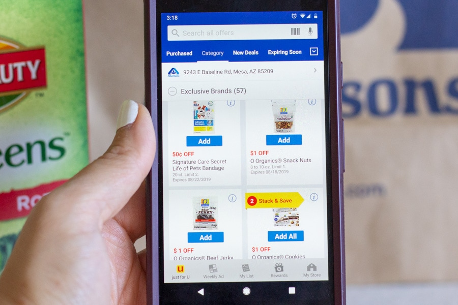 View of cell phone on Albertsons coupon page.
