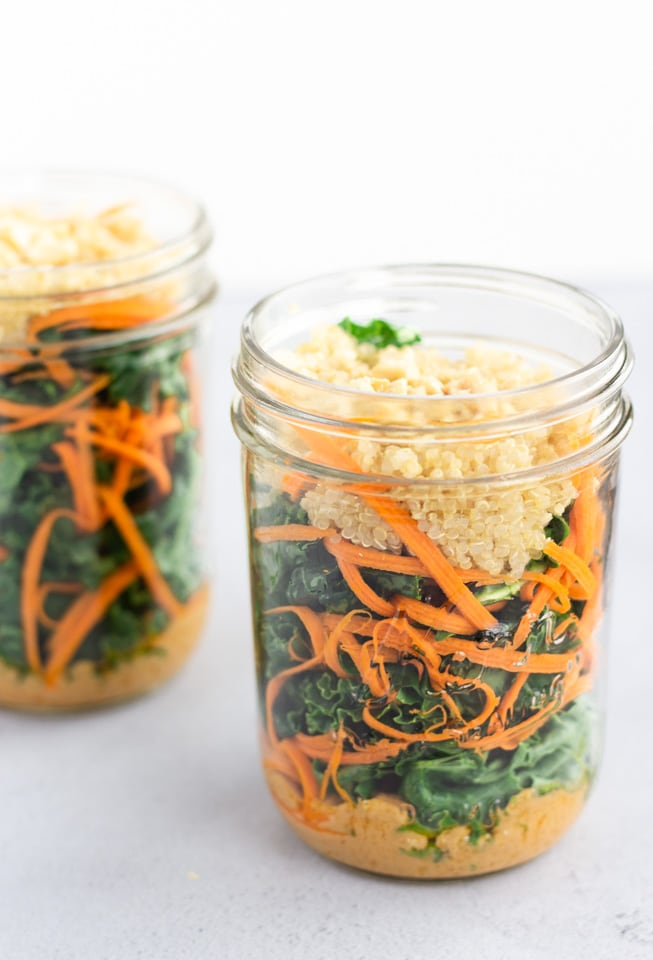 Layered Kale salad in a mason jar.