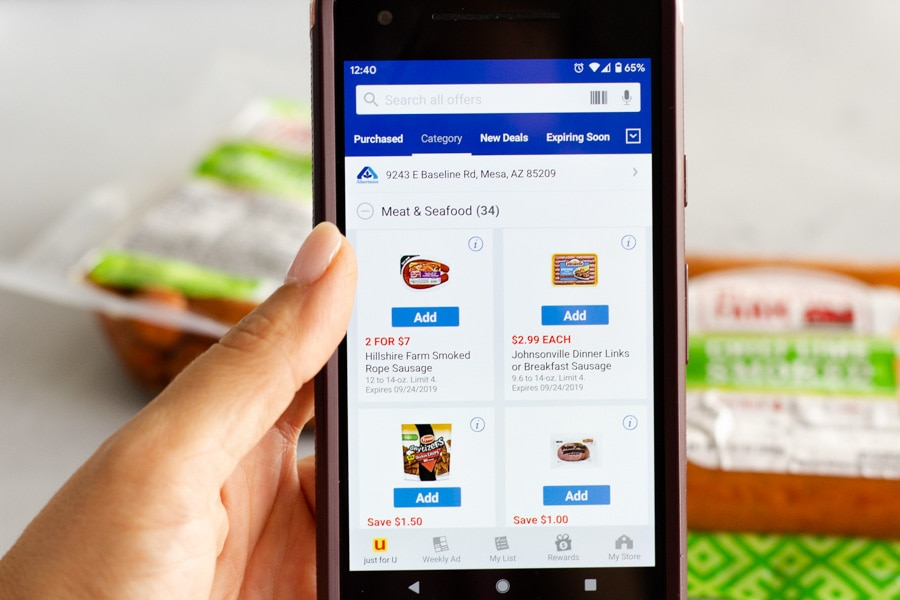 Mobile phone showing Albertsons coupon page