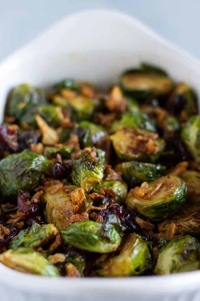 Roasted Brussel Sprouts in a white serving dish