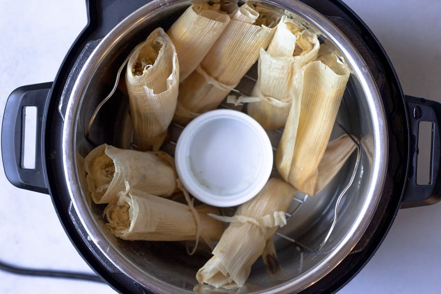 Tamales inside an instant pot ready to be cooked.