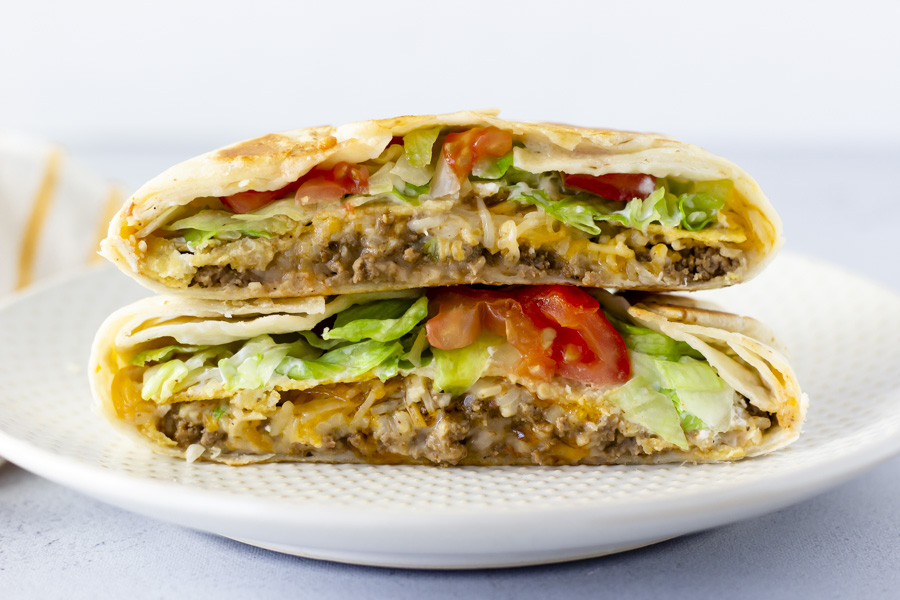 Crunch wrap cut in half and stacked on top of each other.
