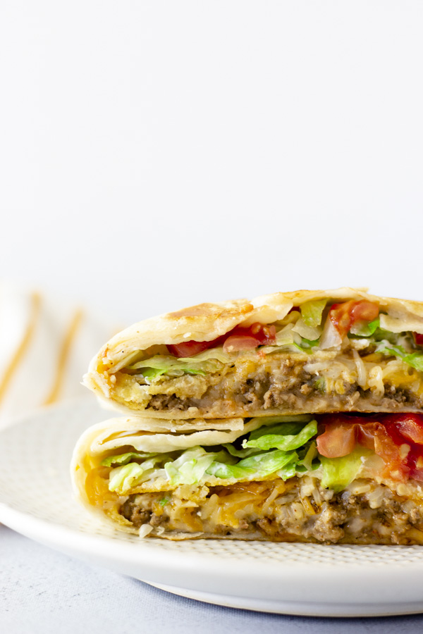 Crunchwraps cut in half and stacked on top of each other,