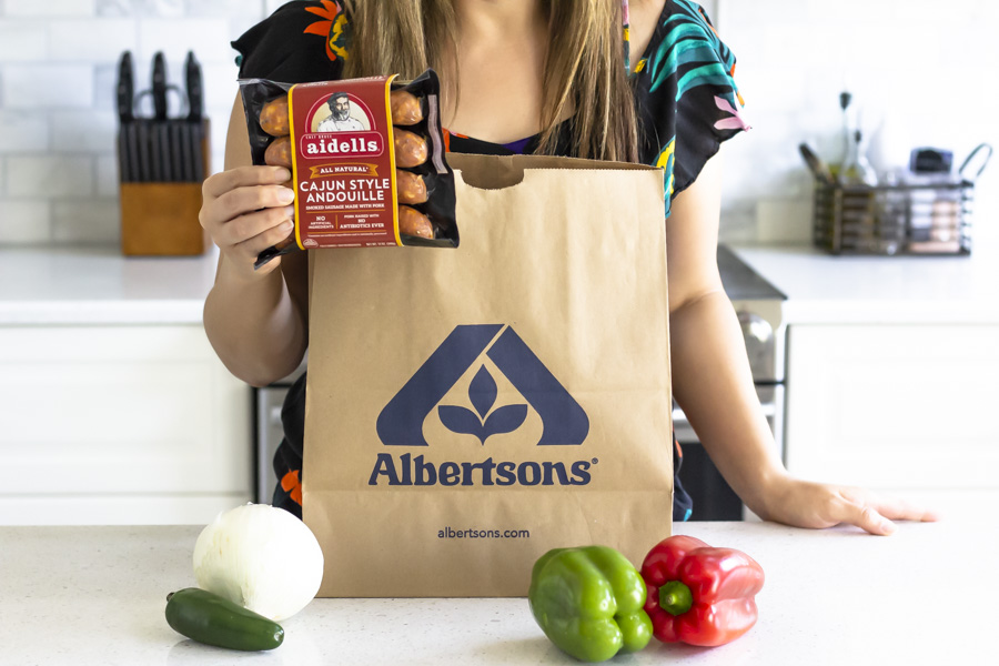 Brown Albertsons paper bag on a counter and ingredients being taken out of the bag.