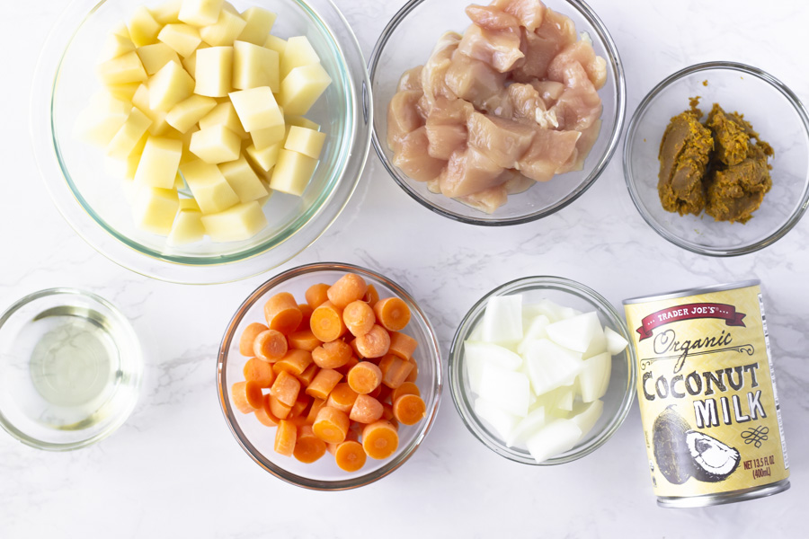 Ingredients- potatoes, chicken, carrots, onions, curry paste, coconut milk and oil.