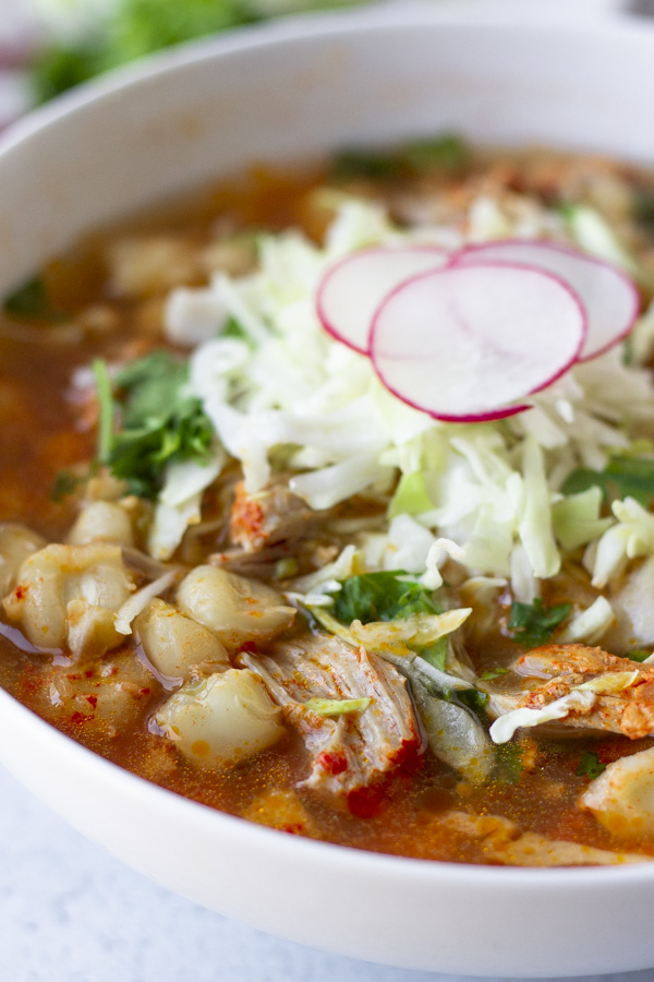 Zoomed in view of posole showing pieces of hominy and pork.