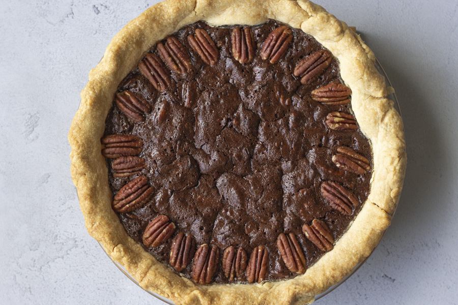 Overhead view of whole chocolate pecan pie.