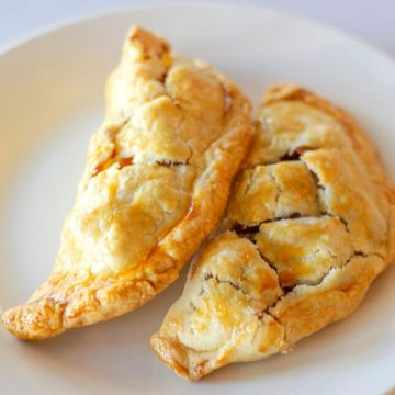 2 hand pies on a white plate