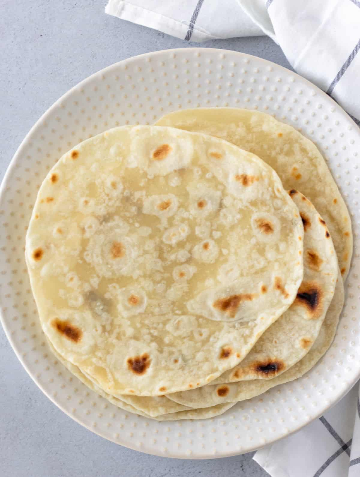 Overhead view of tortillas on a plate.