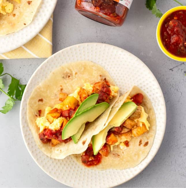 Square feature image of 2 tacos on a plate with a small bowl of salsa on the side.