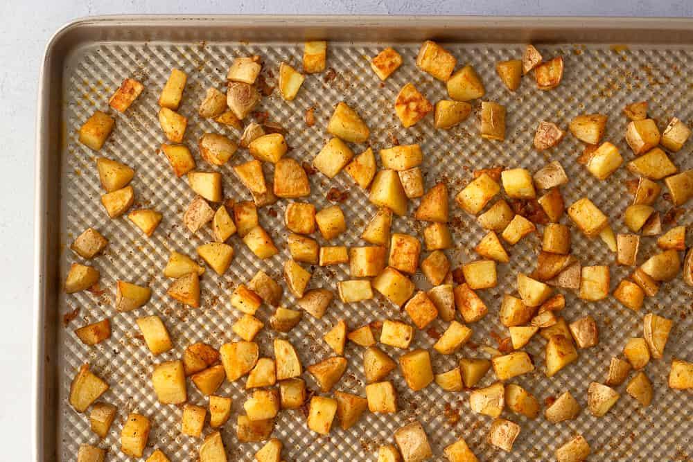 Sheet pan of baked crispy potatoes.