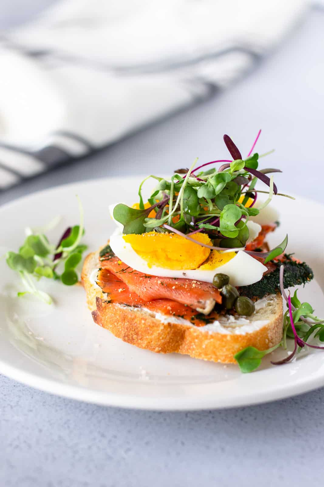 Salmon lox toast with hard boiled egg and micro greens on top