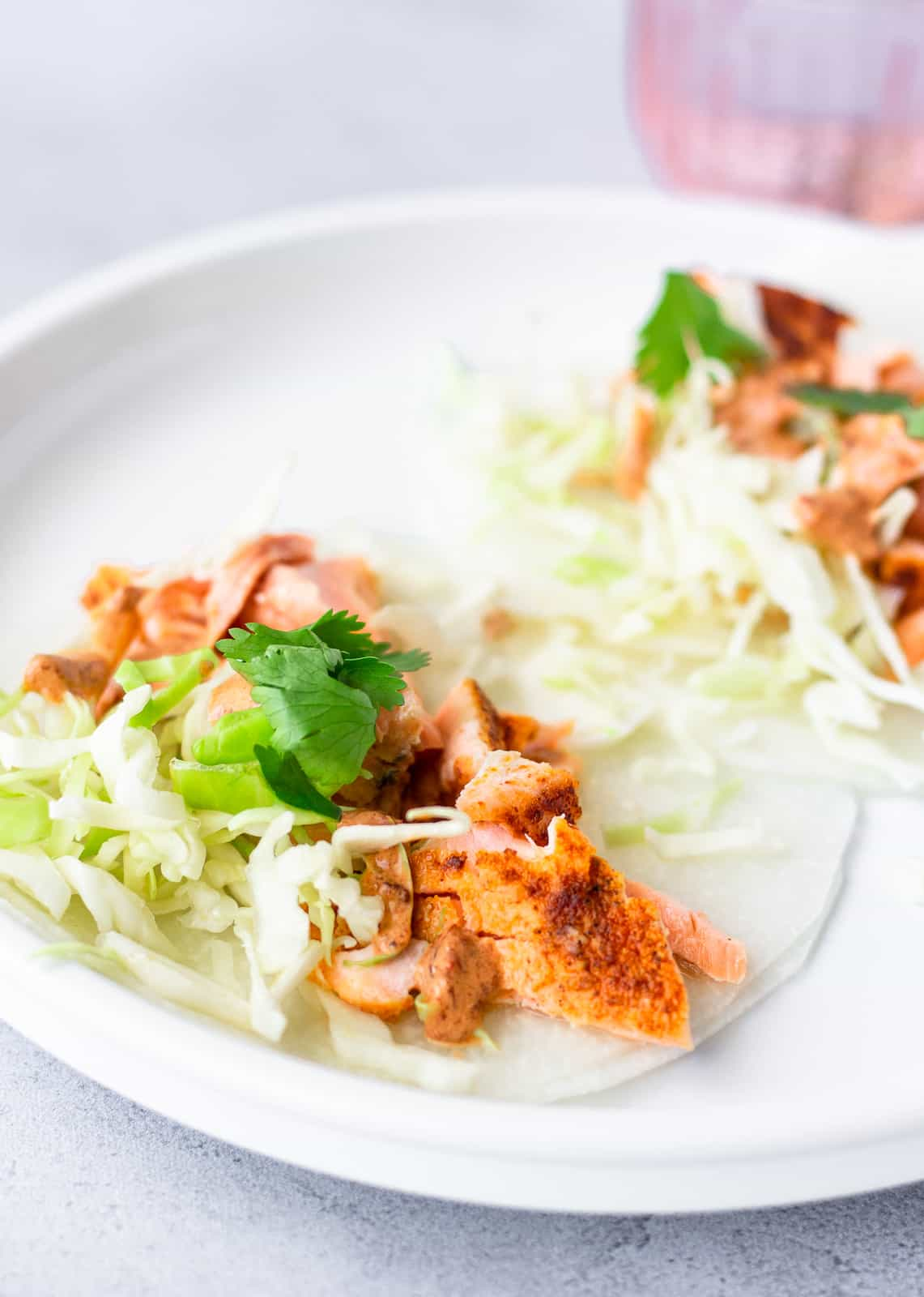 Flaked salmon on jicama wraps with shredded lettuce and cilantro.