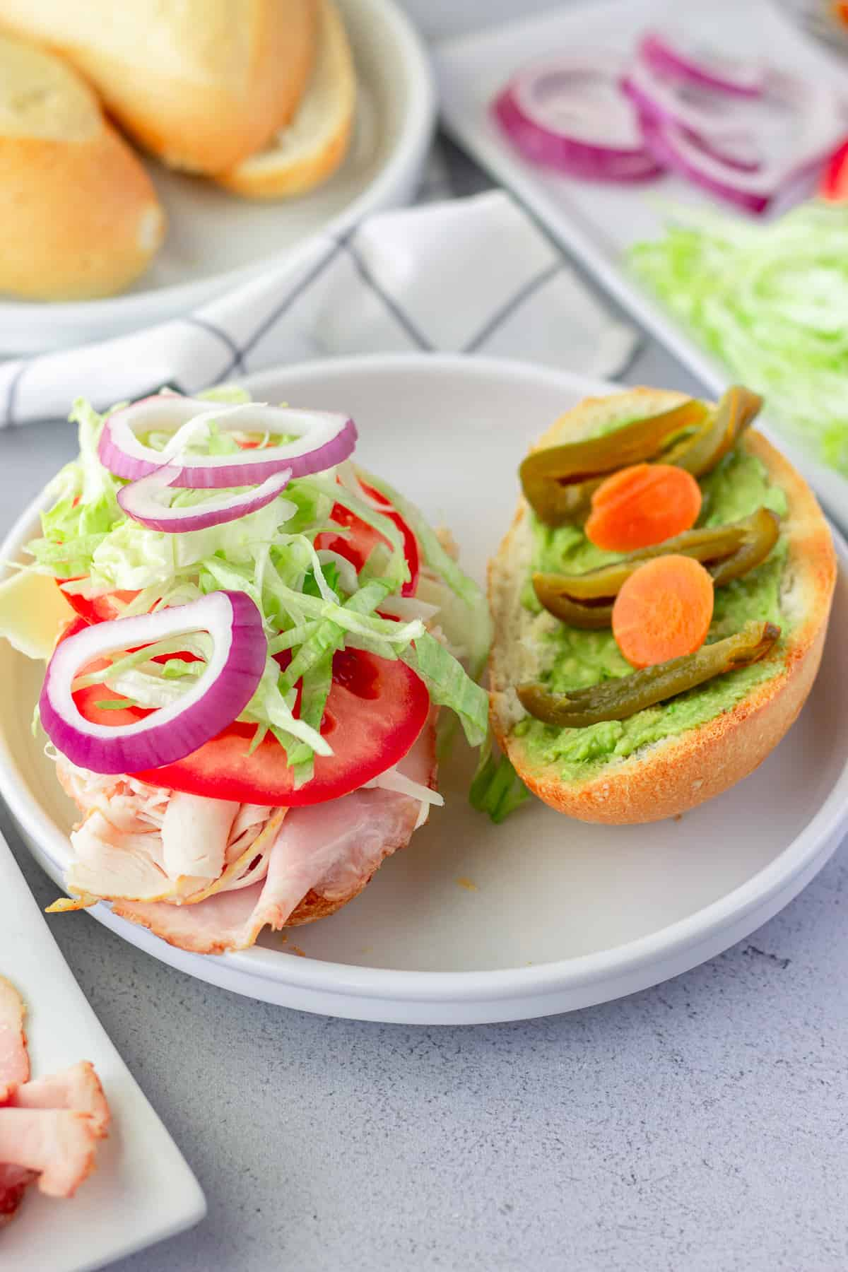 Open faced lonche to show ingredients inside the sandwich.